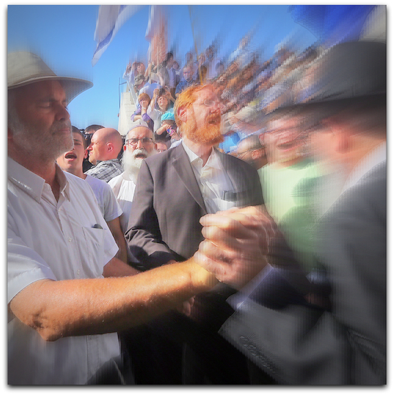 Hallels father, Amichai, grips Rabbi's hand at Jerusalem's Temple Mount ( Photo: by Gil Yohanan YNet News)
