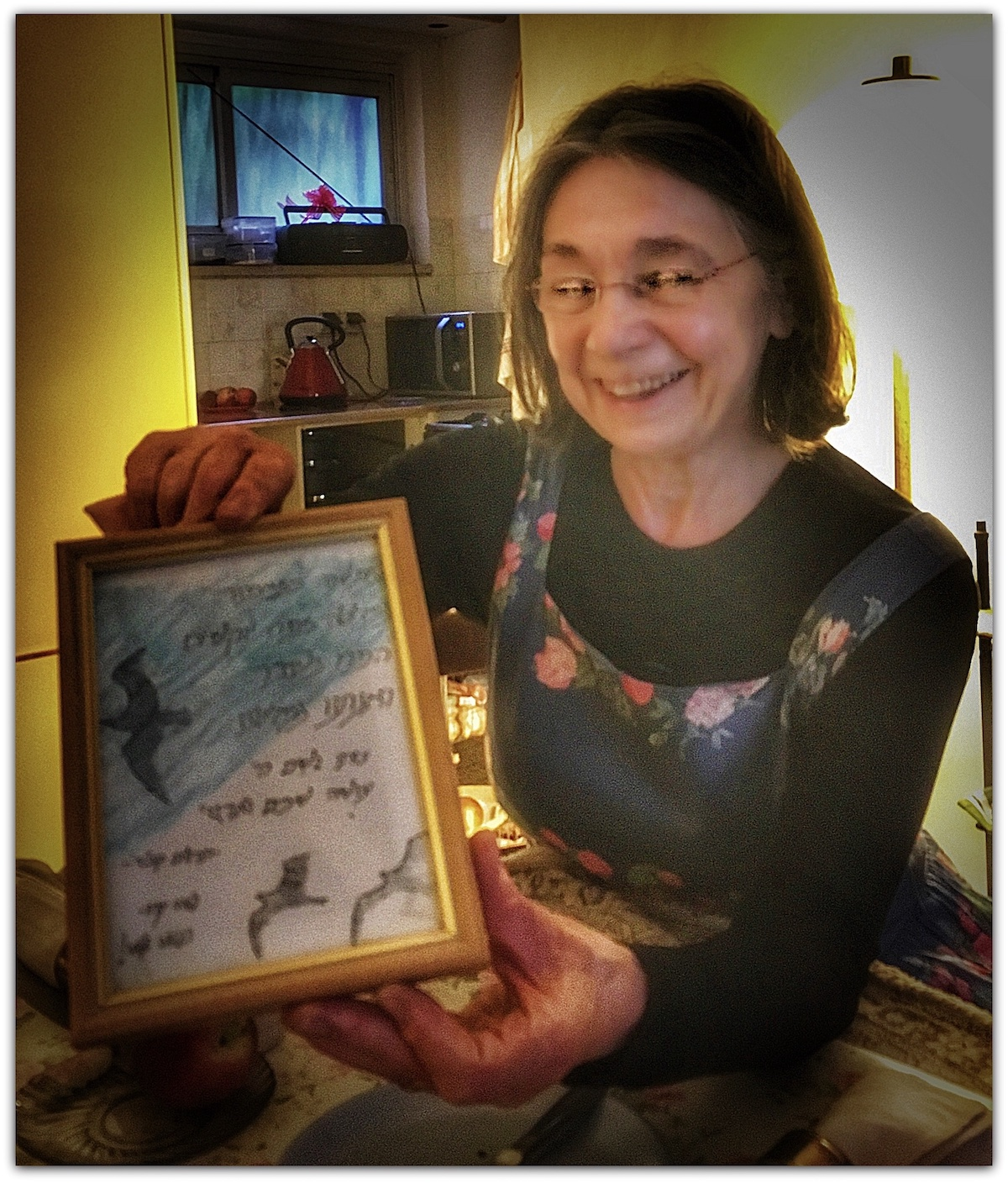Petra Heldt holding poem presented by Yeshiva girls while she was recovering from a suicide bomber attack