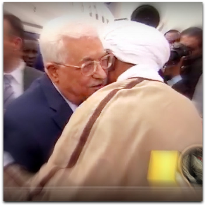 Abbas embraces Sudan war criminal Omar al Bashir (YouTube screenshot, the official channel of